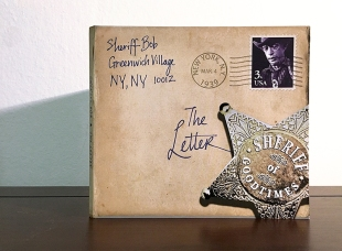CD cover design/production. Bluegrass artist Sheriff Bob wanted his CD album to look like an old letter. I used his photo to create the stamp, then postmarked it with his birthdate.
